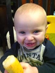 Happy boy loving his banana!